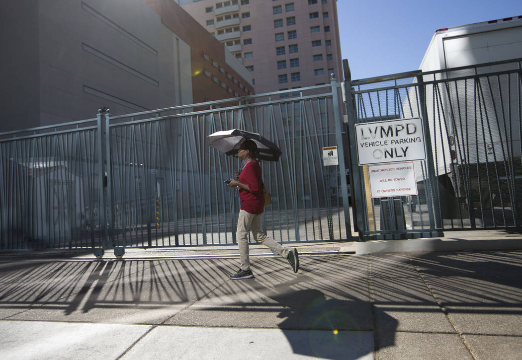 A woman carries an umbrella to protect herself from the sun as she walks in downtown Las Vegas on Thursday, June 15, 2017. Richard Brian Las Vegas Review-Journal @vegasphotograph