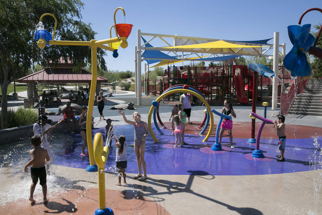 Kids play at the waterpark in Centennial Hills Park in North Las Vegas, Thursday, June 15, 2017. Gabriella Angotti-Jones  Las Vegas Review-Journal @gabriellaangojo