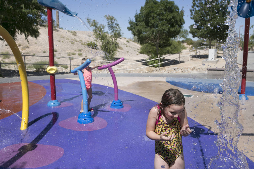 Scarlet Burgoin, 6, who is visiting her dad from Arizona,  plays at the waterpark in Centennial Hills Park in North Las Vegas, Thursday, June 15, 2017. Gabriella Angotti-Jones  Las Vegas Review-Jo ...