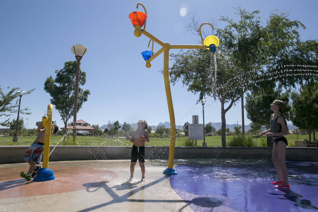 From left: Eric Taylor, 5, Matt Perkins, 6, and Abigail Hoguin, 11, all from North Las Vegas, play at the waterpark in Centennial Hills Park in North Las Vegas, Thursday, June 15, 2017. Gabriella  ...