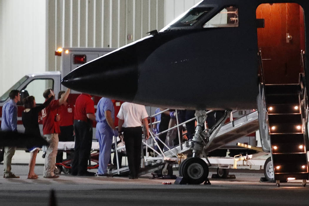 The legs of Otto Warmbier, a 22-year-old University of Virginia undergraduate student who was imprisoned in North Korea in March 2016, are seen as medical personnel transfer him from a transport a ...