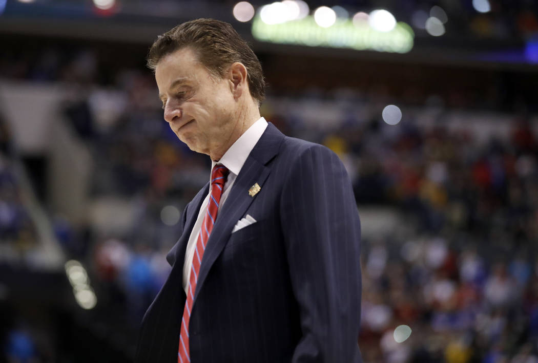Louisville head coach Rick Pitino walks off the court after a 73-69 loss to Michigan in a second-round game in the men's NCAA college basketball tournament in Indianapolis on March 19, 2017. The N ...