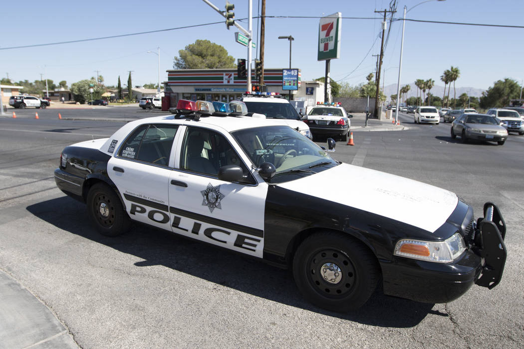 Las Vegas police investigate the scene of a man armed with a knife at a residence near West Washington Avenue and North Decatur Avenue in Las Vegas on Thursday, June 15, 2017.  (Richard Brian Las  ...