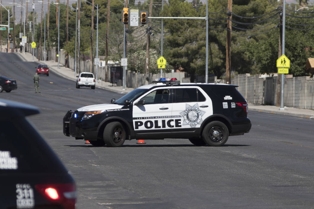 Las Vegas police investigate the scene of a man armed with a knife at a residence near West Washington Avenue and North Decatur Avenue in Las Vegas on Thursday, June 15, 2017. (Richard Brian Las V ...