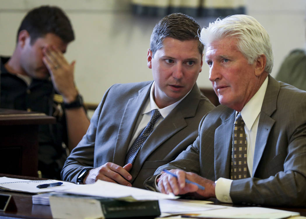 Former University of Cincinnati police officer Raymond Tensing, left, speaks with his lawyer, Stew Mathews, right, during his retrial, Wednesday, June 14, 2017, in the Hamilton County Courthouse i ...