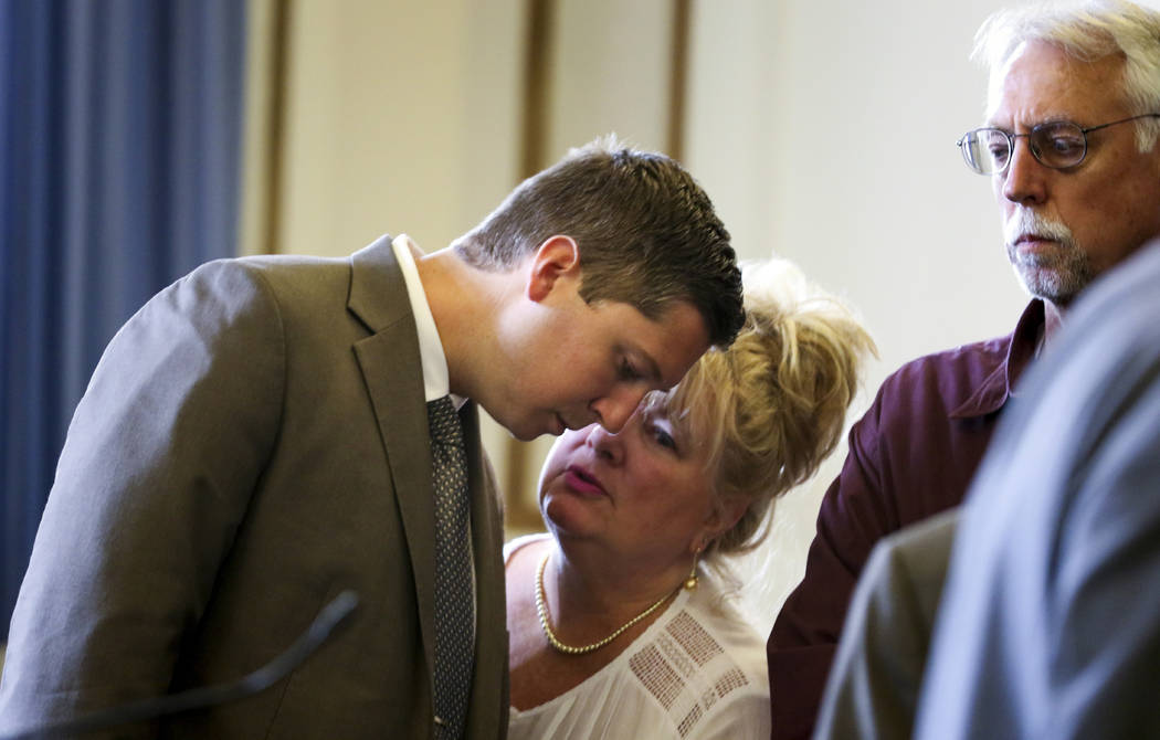 Former University of Cincinnati police officer Raymond Tensing talks to his mother, Amy Tensing, at the conclusion of his retrial, Wednesday, June 14, 2017, in the Hamilton County Courthouse in Ci ...