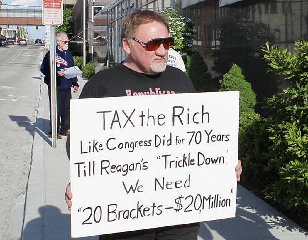 In this undated file photo, James Hodgkinson holds a sign during a protest outside of a United States Post Office in Belleville, Ill. Hodgkinson has been identified as the suspect in the Wednesday ...