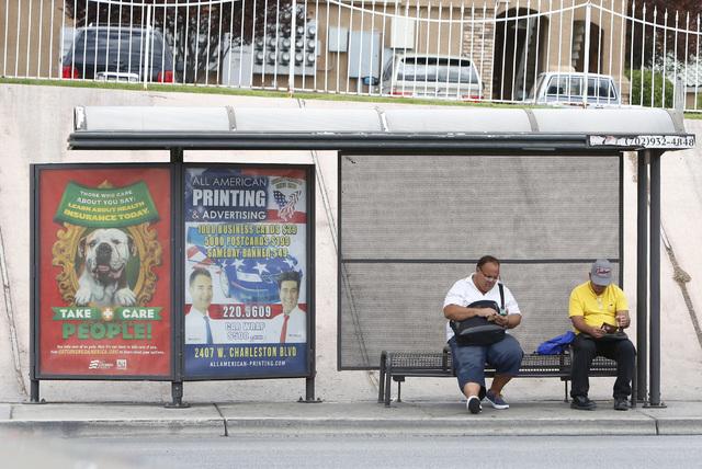 Commuters wait at a bus stop near Tropicana Avenue and Wynn Road on Thursday, July 9, 2015. (Bizuayehu Tesfaye/Las Vegas Review-Journal) Follow Bizu Tesfaye on Twitter @bizutesfaye