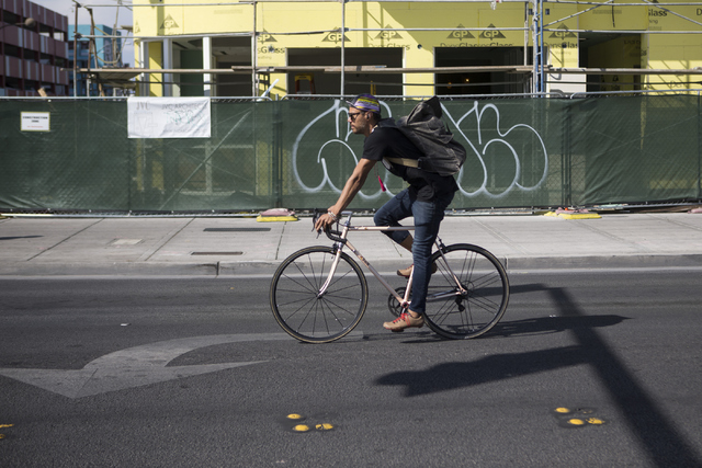 A bicyclist rides near Fremont Street and 7th Street on Tuesday, May 24, 2016, in Las Vegas. (Erik Verduzco/Las Vegas Review-Journal Follow @Erik_Verduzco)