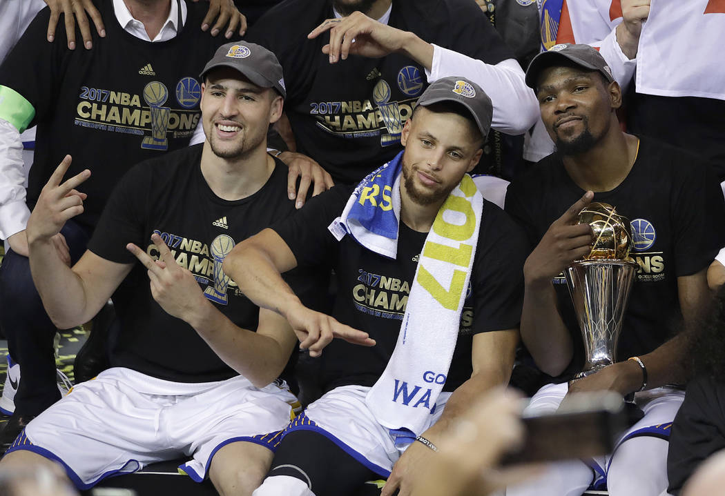 Golden State Warriors guard Klay Thompson, from left, guard Stephen Curry and forward Kevin Durant celebrate after Game 5 of basketball's NBA Finals against the Cleveland Cavaliers in Oakland, Cal ...