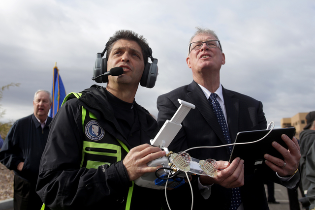 Kevin Fallico, the Director of Operations for Avisight, helps Henderson Mayor Andy Hafen fly a drone at an event to break ground on Nevada's first unmanned aerial systems urban test site on Wednes ...