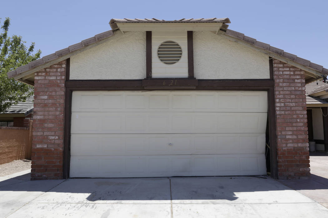 A boarded-up house is seen near Lone Mountain Road and Jones Boulevard in Las Vegas, Wednesday, June 28, 2017. Despite the improving housing market, Las Vegas officials are boarding up an increasi ...
