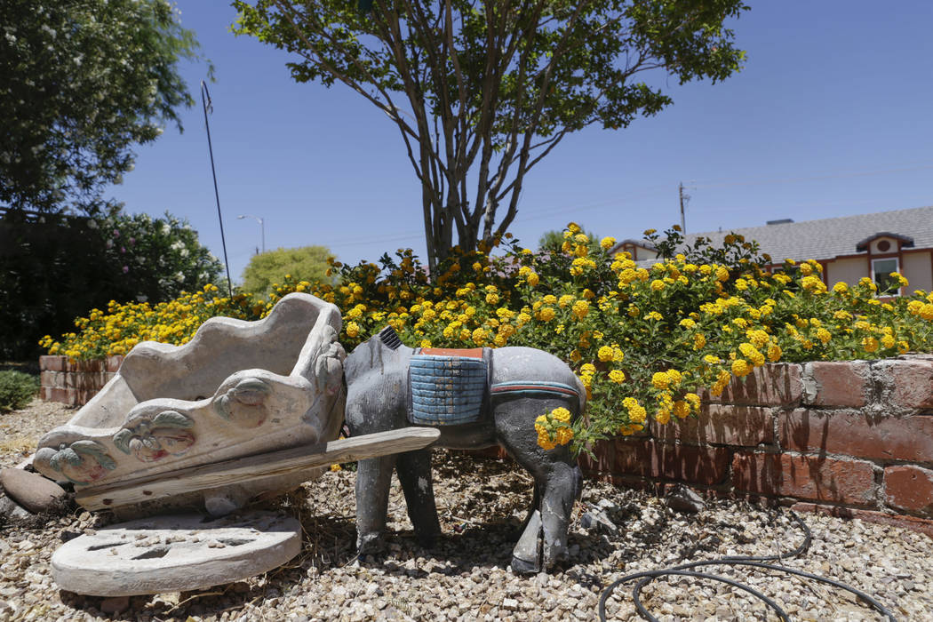 Broken garden decorations are seen at a boarded-up house near Lone Mountain Road and Jones Boulevard in Las Vegas, Wednesday, June 28, 2017. Despite the improving housing market, Las Vegas officia ...