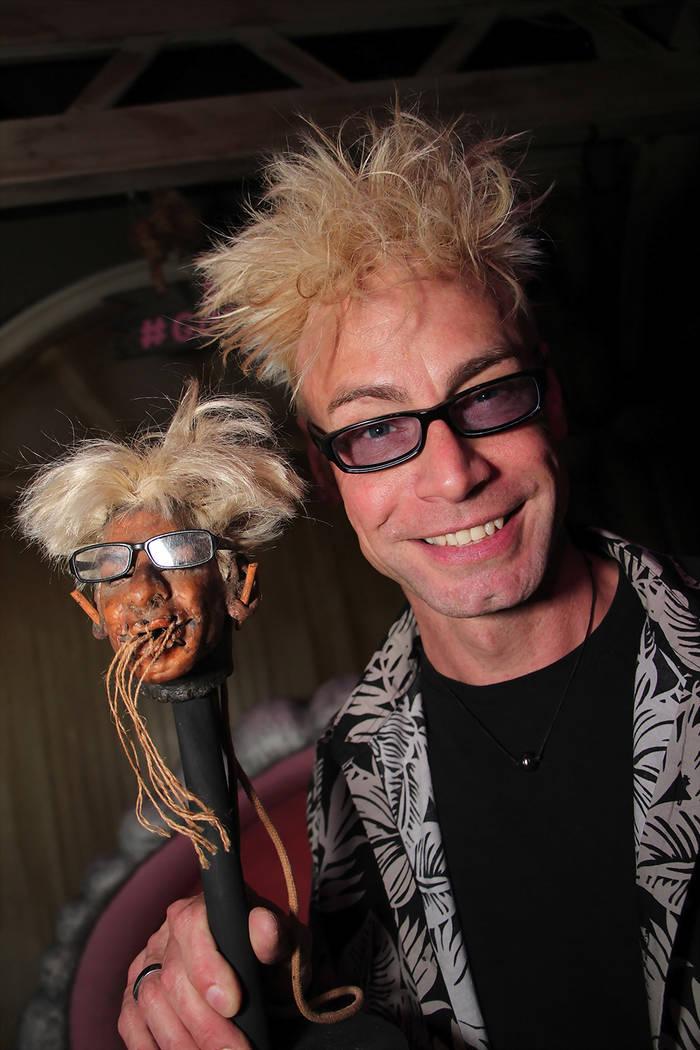 Celebrity magician Murray Sawchuck and his shrunken head artwork. (CR Hew Burney)