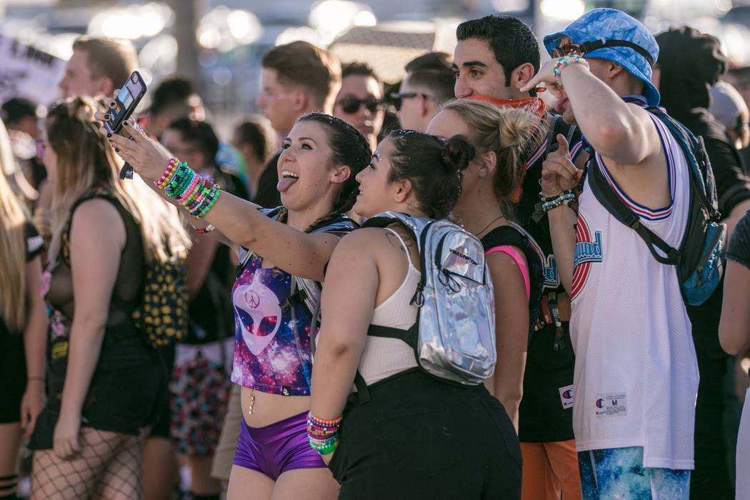 Las Vegas resident Brooklyn Bennion takes a quick selfie with her friends in line for the opening day of Electric Daisy Festival at Las Vegas Motor Speedway on Friday, June 16, 2017, in Las Vegas. ...