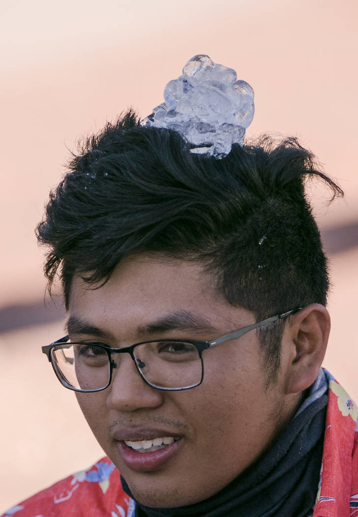 Ian Catacutan puts ice cube on his head and cools off before the opening of the Electric Daisy Carnival at Las Vegas Motor Speedway on Friday, June 16, 2017, in Las Vegas. Morgan Lieberman Las Veg ...
