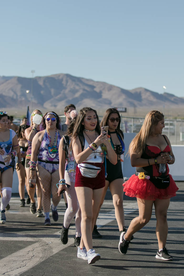 Colorful pedestrians cross the street towards Las Vegas Motor Speedway on Friday, June 16, 2017, in Las Vegas, for the opening day of Electric Daisy Festival. Morgan Lieberman Las Vegas Review-Journal