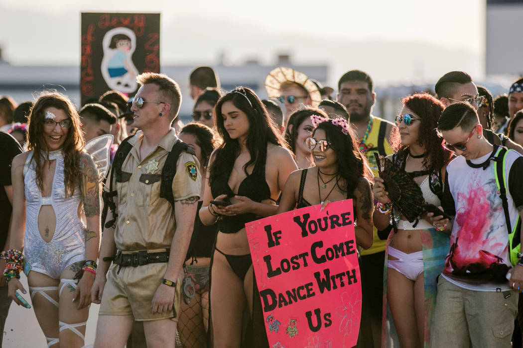 Electric Daisy Carnival attendees leave the parking lot in a large pack at Las Vegas Motor Speedway on Friday, June 16, 2017, in Las Vegas. Morgan Lieberman Las Vegas Review-Journal