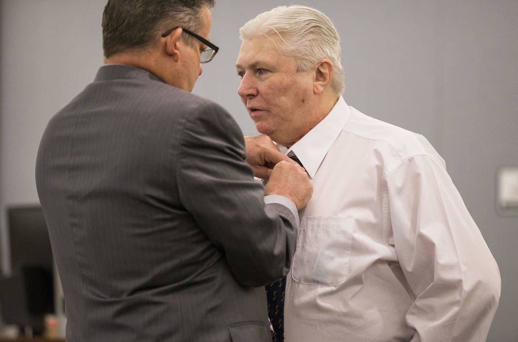Thomas Randolph, right, gets help with his tie from his attorney Clark Patrick before hearing opening statements in his murder trial at the Regional Justice Center in downtown Las Vegas on Friday, ...