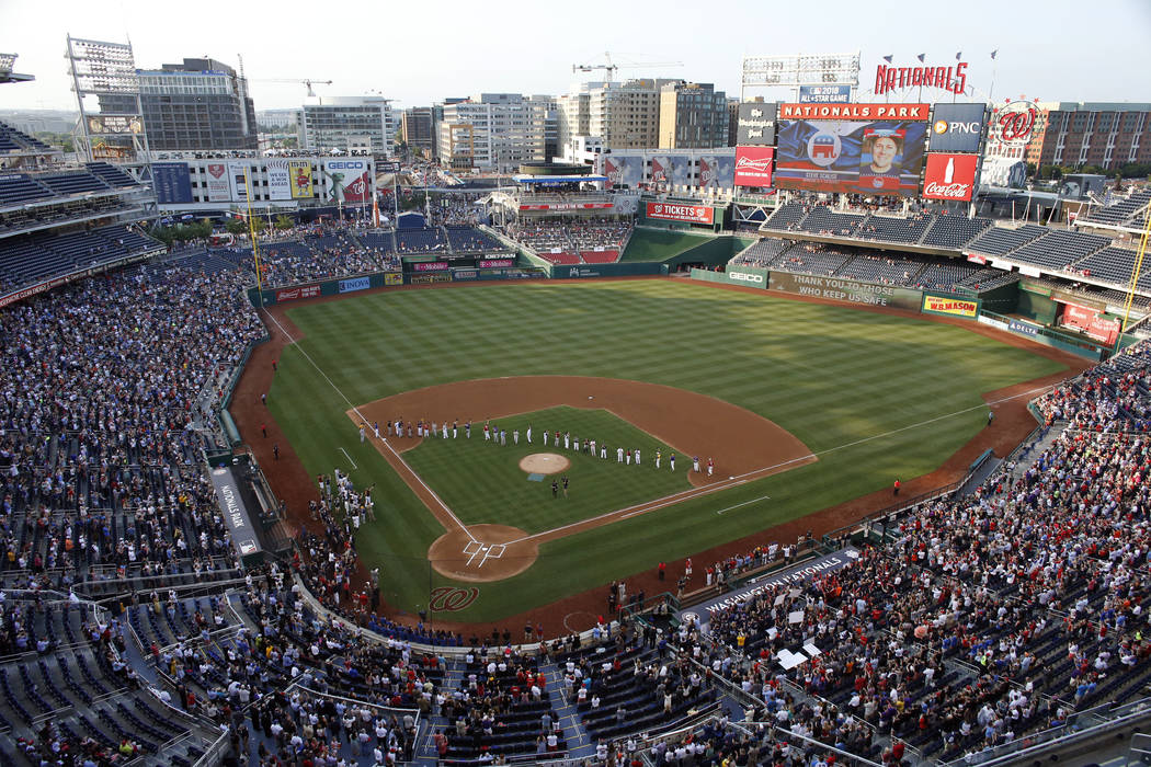A photo of House Majority Whip Steve Scalise, R-La., is seen on the video board as the last member of the Republican team announced before the Congressional baseball game, Thursday, June 15, 2017, ...