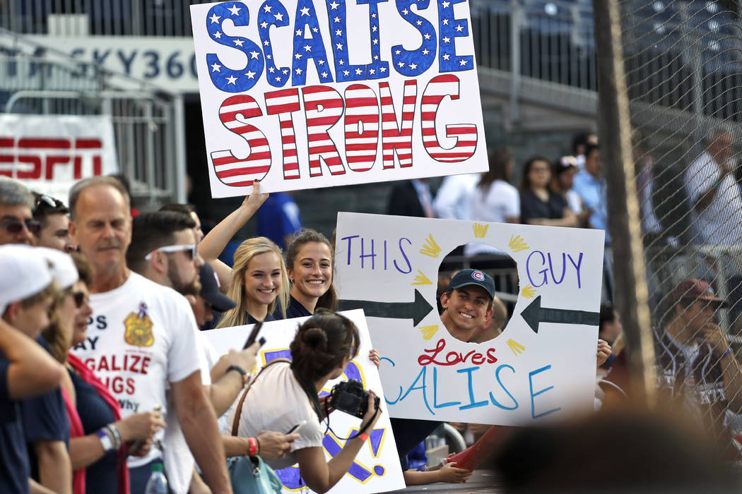 Supporters of House Majority Whip Steve Scalise, R-La., hold signs before the Congressional baseball game, Thursday, June 15, 2017, in Washington. The annual GOP-Democrats baseball game raises mon ...