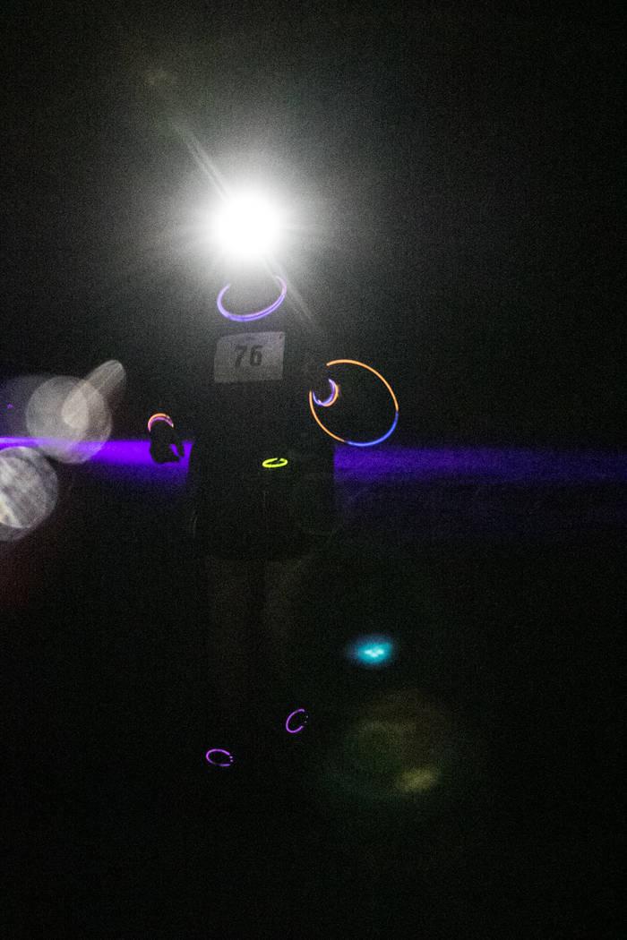 The Glow Worm 5K Fun Run began at 9 p.m. at Equestrian Park South and Trailhead on Saturday, June 17, 2017, in Las Vegas. (Morgan Lieberman/Las Vegas Review-Journal)