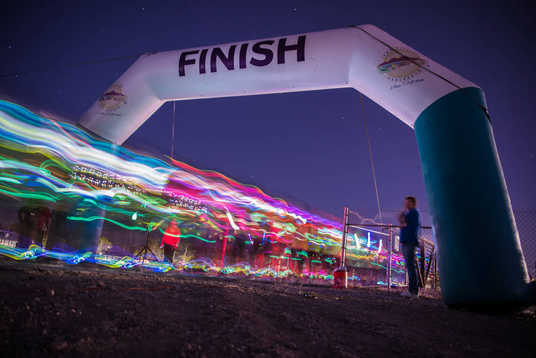 The start of the Glow Worm 5K Fun Run at Equestrian Park South and Trailhead on Saturday, June 17, 2017, in Las Vegas. (Morgan Lieberman/Las Vegas Review-Journal)