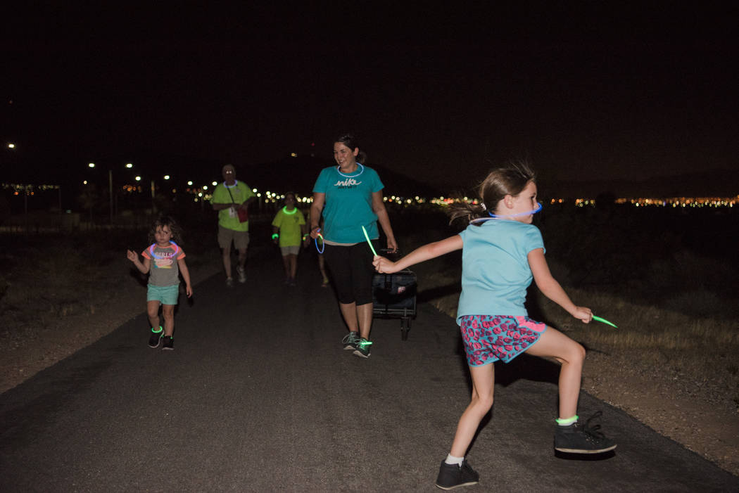 Lucy White, 5, dances to her own beat during the Glow Worm 5K Fun Run  at Equestrian Park South and Trailhead on Saturday, June 17, 2017, in Las Vegas. (Morgan Lieberman/Las Vegas Review-Journal)