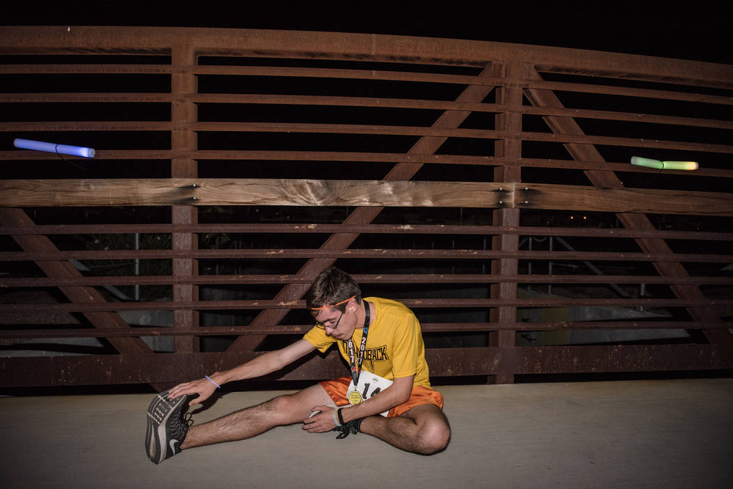 Traylin Reece Ruch stretches post race at the Glow Worm 5K Fun Run  at Equestrian Park South and Trailhead on Saturday, June 17, 2017, in Las Vegas. (Morgan Lieberman/Las Vegas Review-Journal)