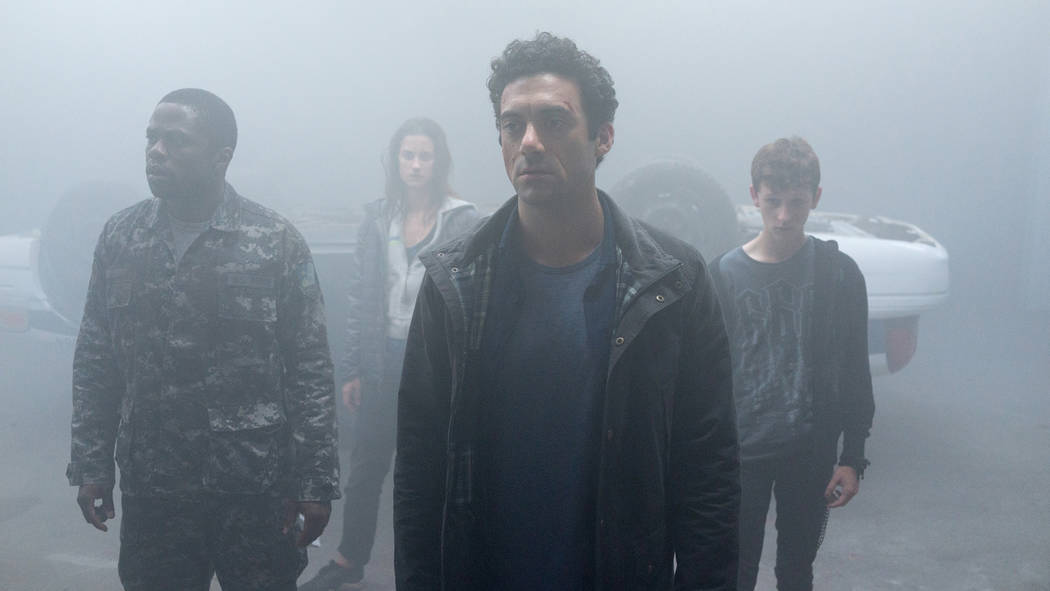 From l to r:  Bryan Hunt (Okezie Morro), Mia Lambert (Danica Curcic), Kevin Copeland (Morgan Spector) and Adrian Garf (Russell Posner) seek sanctuary from an eerie and foreboding mist containing a ...