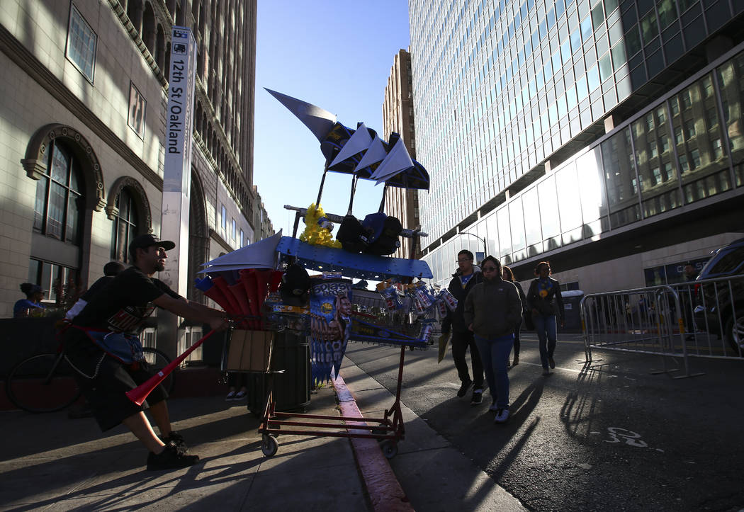 A vendor near the start of the Golden State Warrior's victory parade route in downtown Oakland, Calif. on Thursday, June 15, 2017. Chase Stevens Las Vegas Review-Journal @csstevensphoto