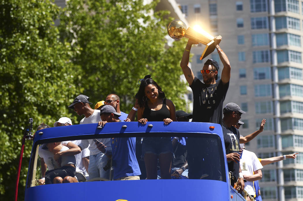 Golden State Warriors' Stephen Curry and his wife Ayesha, left, during the team's victory parade and rally in downtown Oakland, Calif. on Thursday, June 15, 2017. Chase Stevens Las Vegas Review-Jo ...
