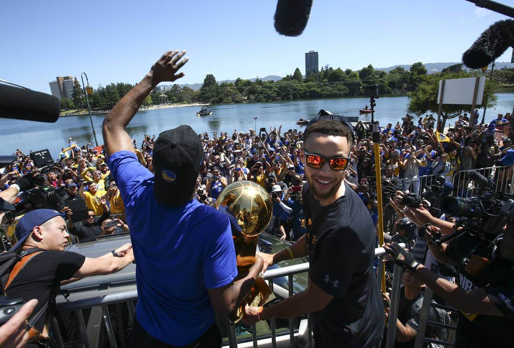 Golden State Warriors' Ian Clark, left, and Stephen Curry during the team's victory parade and rally in downtown Oakland, Calif. on Thursday, June 15, 2017. Chase Stevens Las Vegas Review-Journal  ...