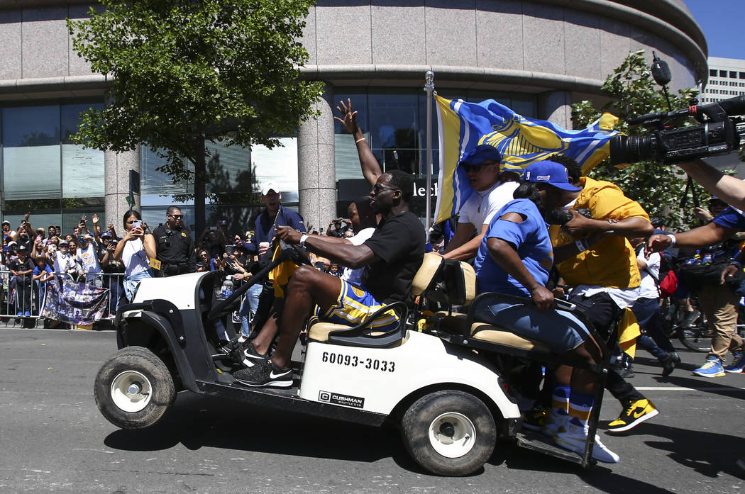 Golden State Warriors' Draymond Green drives a golf cart during the team's victory parade in downtown Oakland, Calif. on Thursday, June 15, 2017. Chase Stevens Las Vegas Review-Journal @csstevensphoto