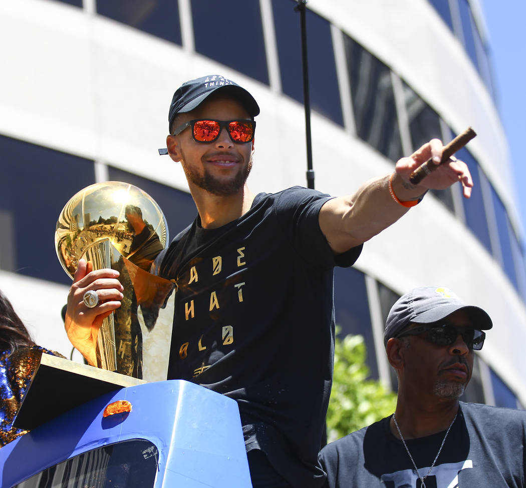 Golden State Warriors' Stephen Curry with the Larry O'Brien trophy during the team's victory parade and rally in downtown Oakland, Calif. on Thursday, June 15, 2017. Chase Stevens Las Vegas Review ...