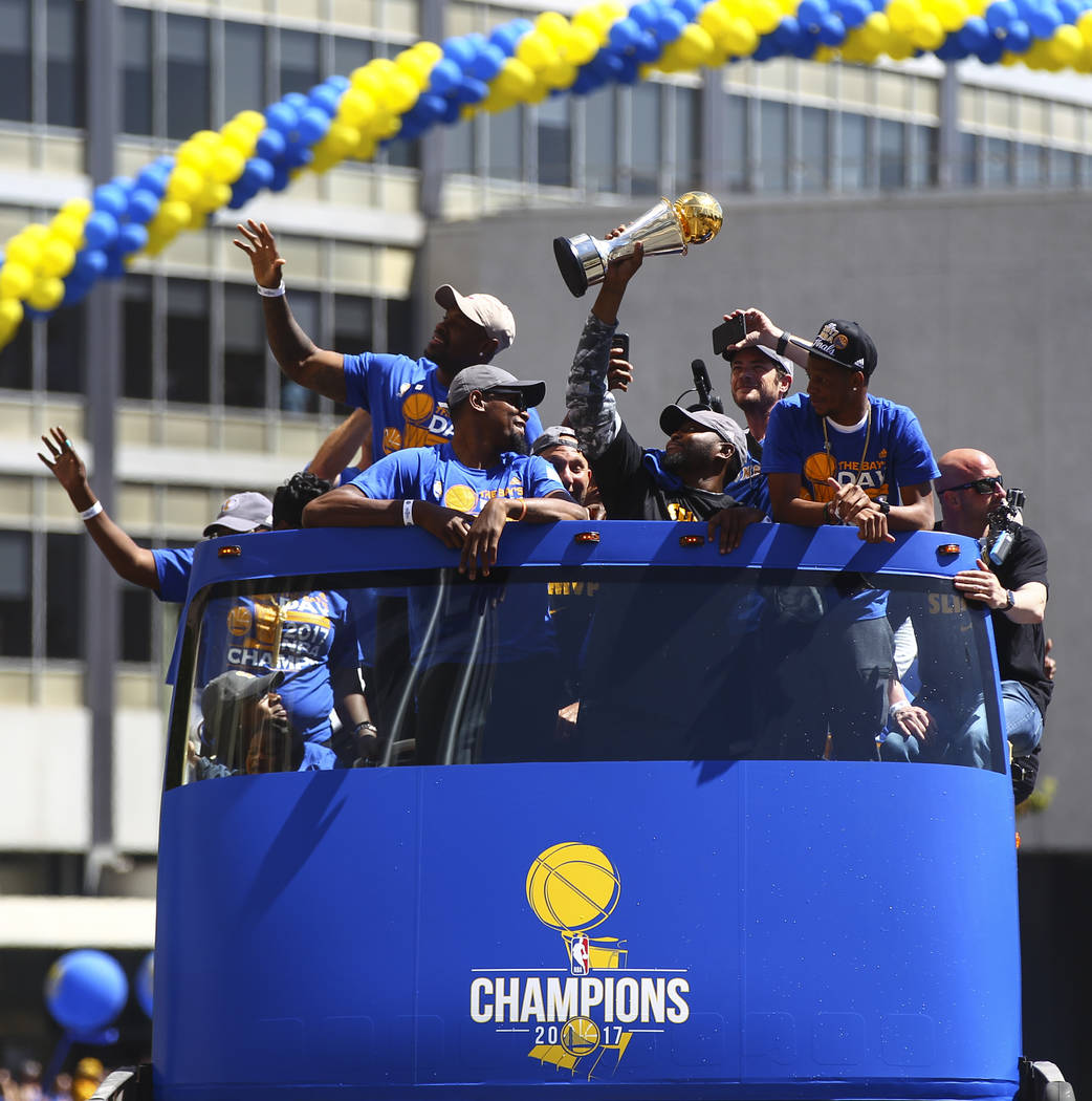 Golden State Warriors' Kevin Durant, center left, during the team's victory parade and rally in downtown Oakland, Calif. on Thursday, June 15, 2017. Chase Stevens Las Vegas Review-Journal @cssteve ...