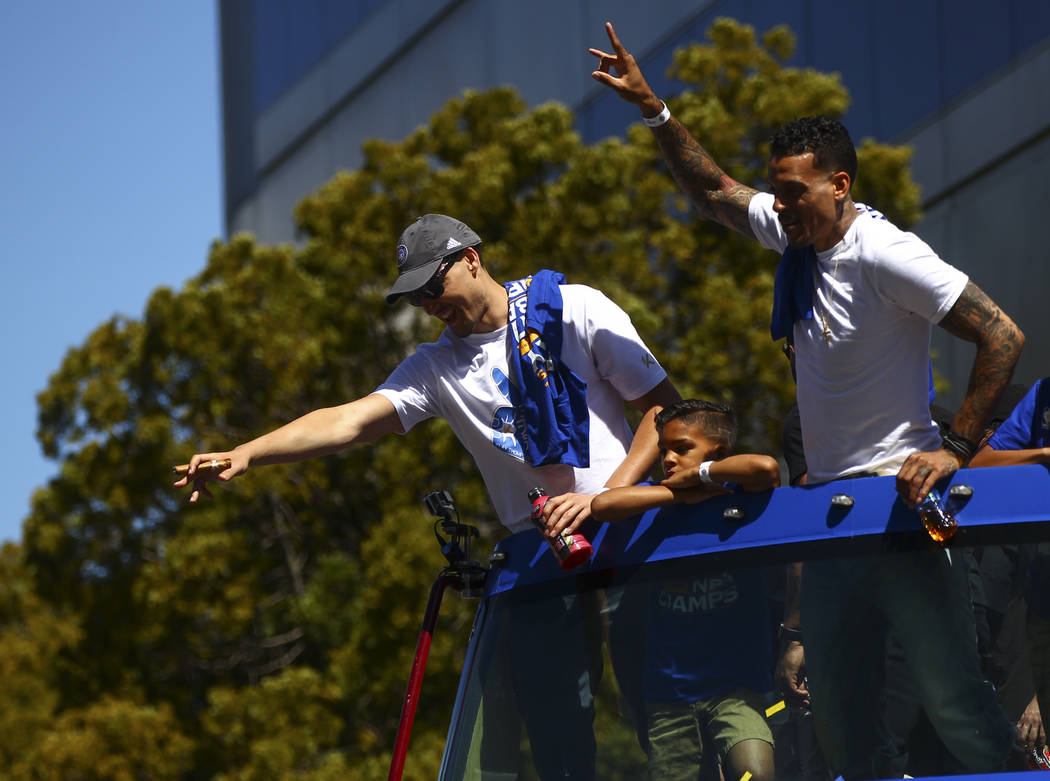 Golden State Warriors' Klay Thompson, left, and Matt Barnes during the Golden State Warrior's victory parade and rally in downtown Oakland, Calif. on Thursday, June 15, 2017. Chase Stevens Las Veg ...