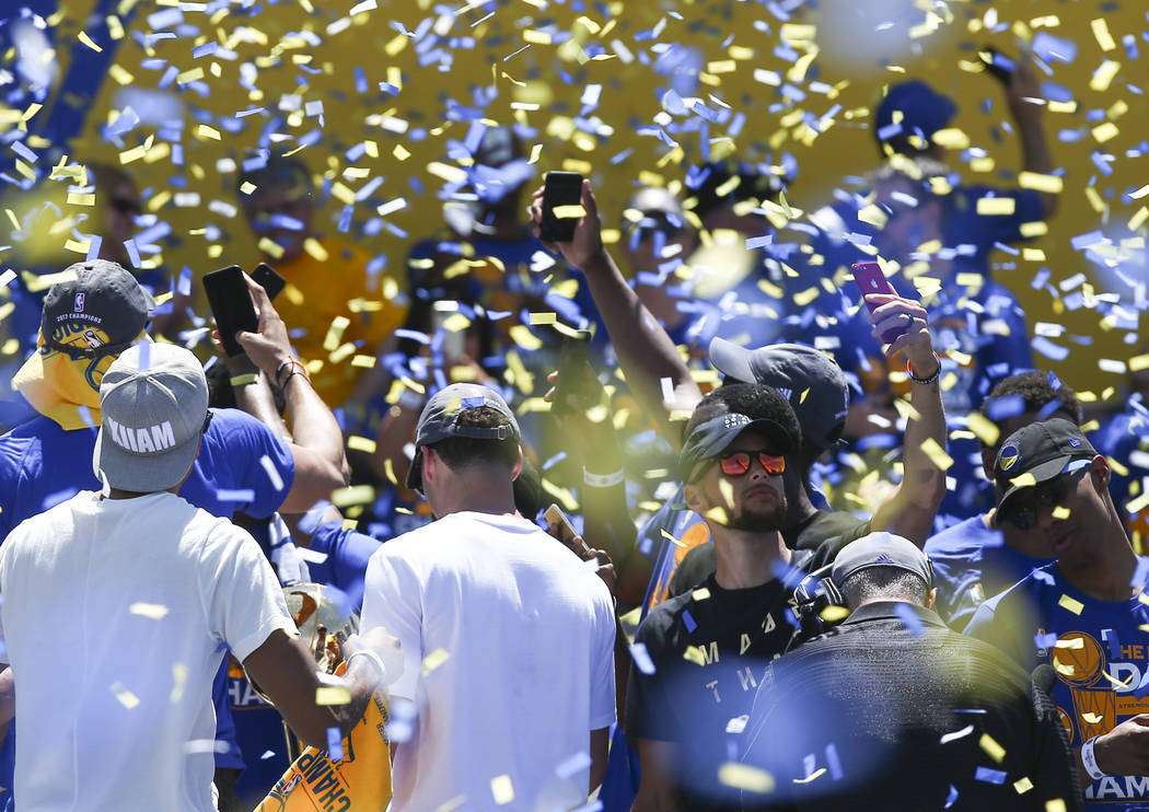 Golden State Warriors' Stephen Curry, lower right, takes a selfie during the team's victory parade and rally in downtown Oakland, Calif. on Thursday, June 15, 2017. Chase Stevens Las Vegas Review- ...