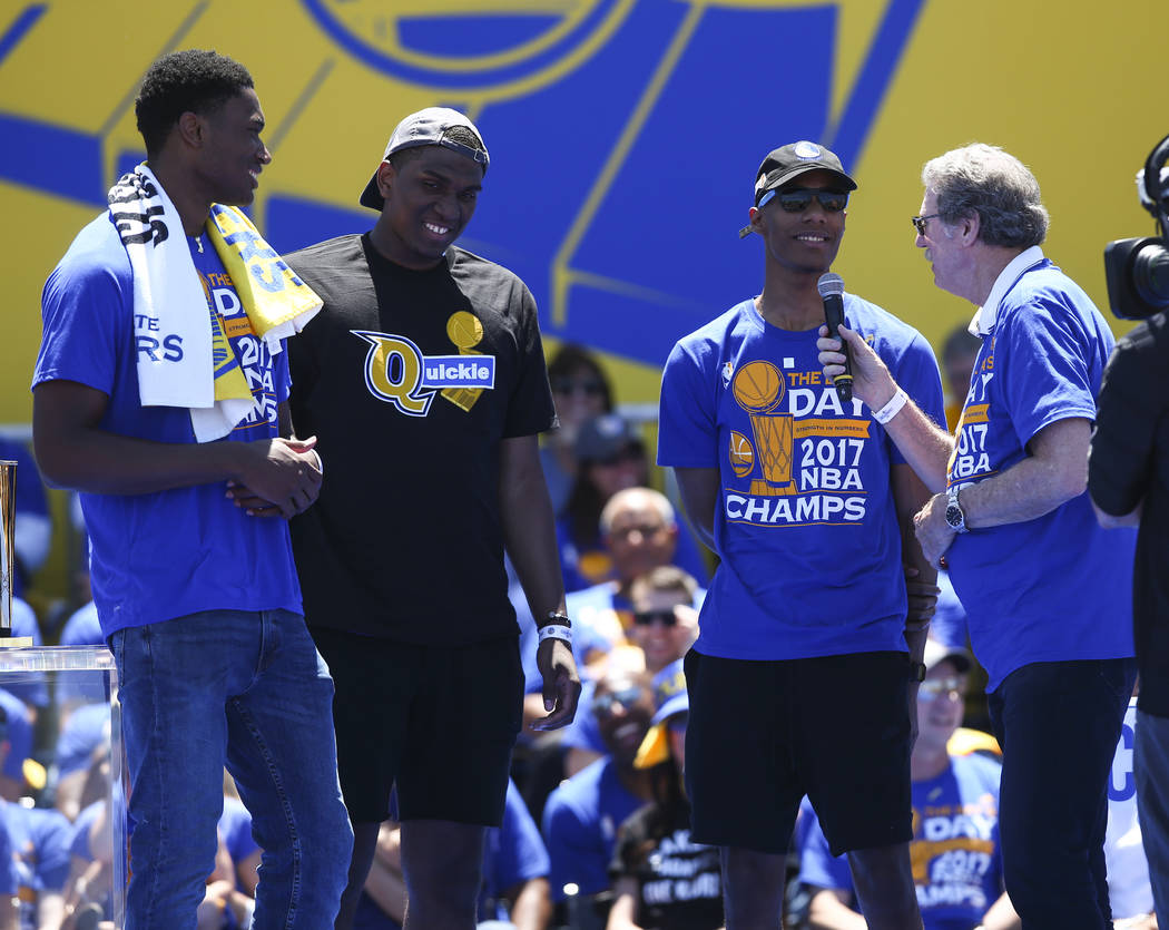 Golden State Warriors' Damian Jones, from left, Kevon Looney, and former UNLV Rebel Patrick McCaw during the team's victory parade and rally in downtown Oakland, Calif. on Thursday, June 15, 2017. ...