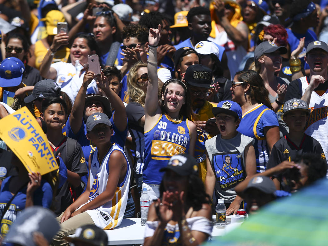 Fans during the Golden State Warrior's victory parade and rally in downtown Oakland, Calif. on Thursday, June 15, 2017. Chase Stevens Las Vegas Review-Journal @csstevensphoto