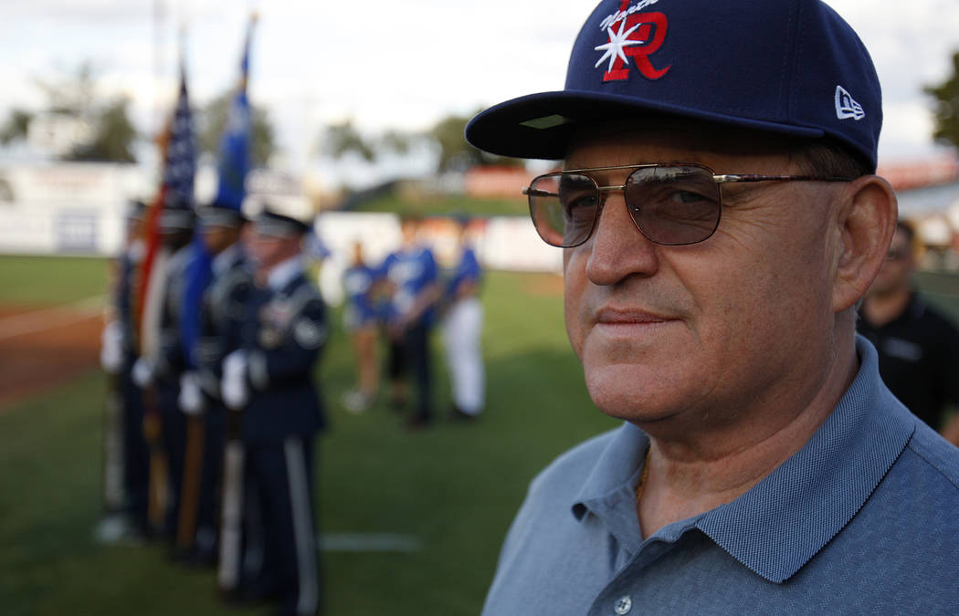 Disabled Vietnam War veteran Bill Anton stands on the diamond at Cashman Field before throwing out the first pitch before the start of the baseball game between the Las Vegas 51s and the Tacoma Ra ...