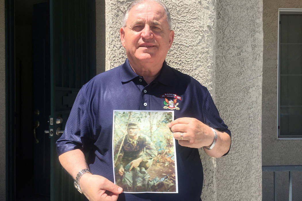 Army Ranger veteran Bill Anton holds a photo of himself in Vietnam in 1972, during an interview Wednesday, April 29, 2015, at his North Las Vegas home. (Keith Rogers/Las Vegas Review-Journal)