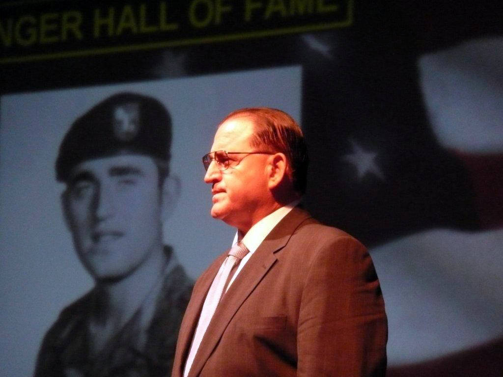 Bill Anton of North Las Vegas stands as his service photo is projected on a screen during his Army Ranger Hall of Fame induction ceremony at Fort Benning, Ga., in August 2009. (Photo courtesy Dona ...