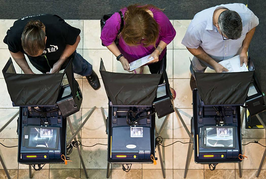 Voters cast ballots during the first day of early voting at the Galleria at Sunset in Henderson on Saturday morning, Oct. 22, 2016. (Daniel Clark/Las Vegas Review-Journal)