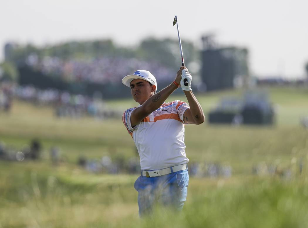Rickie Fowler hits on the 12th hole during the first round of the U.S. Open golf tournament Thursday, June 15, 2017, at Erin Hills in Erin, Wis. (AP Photo/David J. Phillip)