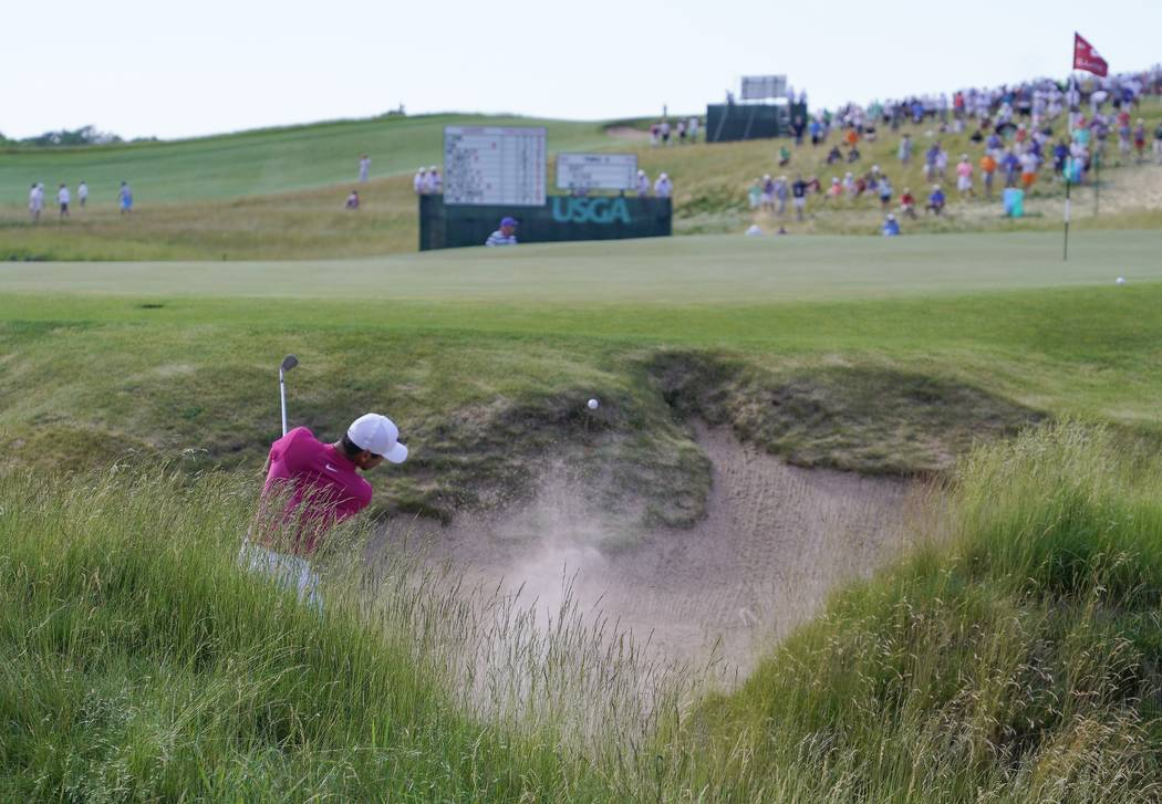 Jason Day, of Australia, hits from a bunker on the ninth hole during the first round of the U.S. Open golf tournament Thursday, June 15, 2017, at Erin Hills in Erin, Wis. (AP Photo/Chris Carlson)