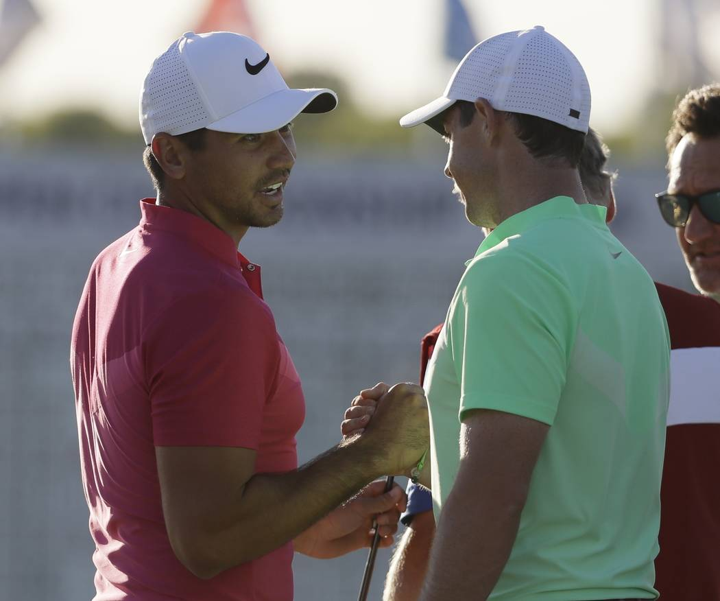 Jason Day, of Australia, shakes hands with Rory Mcilroy, of Ireland, on the 18th hole during the first round of the U.S. Open golf tournament Thursday, June 15, 2017, at Erin Hills in Erin, Wis. ( ...