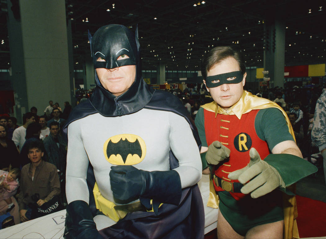 "FILE - In this Jan. 27, 1989, file photo, actors Adam West, left, and Burt Ward, dressed as their characters Batman and Robin, pose for a photo at the ""World of Wheels"" custom ca ..."