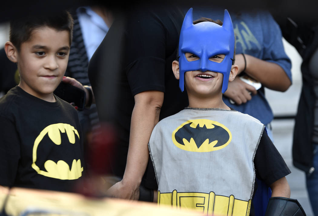 "Twin brothers Augustine Reynoso, left, and Vincent Reynoso, of Rancho Cucamonga, Calif., dress in Batman outfits at a tribute to ""Batman"" star Adam West that includes lighting a  ..."