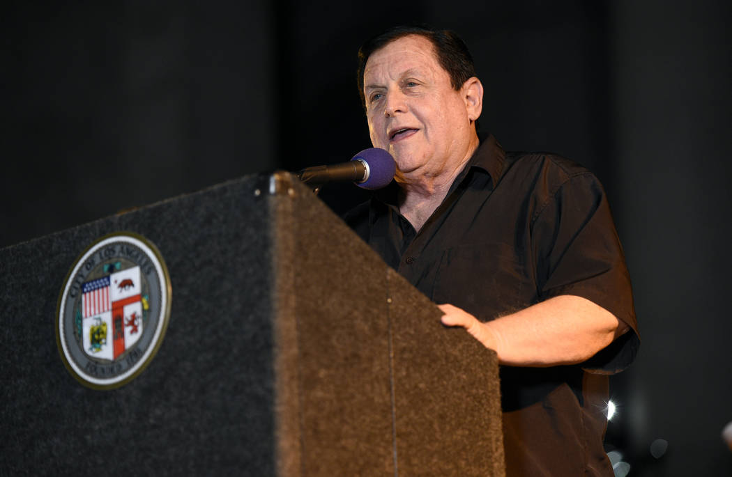 "Burt Ward, who co-starred in the ""Batman"" television series, speaks at a tribute to Adam West that includes lighting a Bat-Signal at City Hall on Thursday, June 15, 2017, in Los  ..."